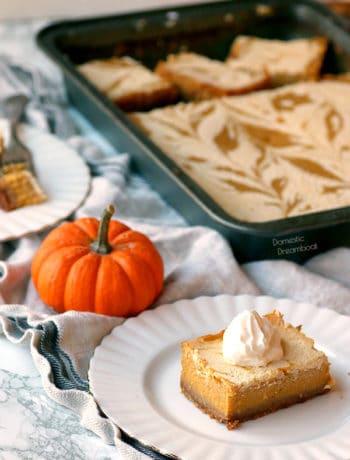 Pumpkin Pie Cheesecake Swirl Bars with whipped cream