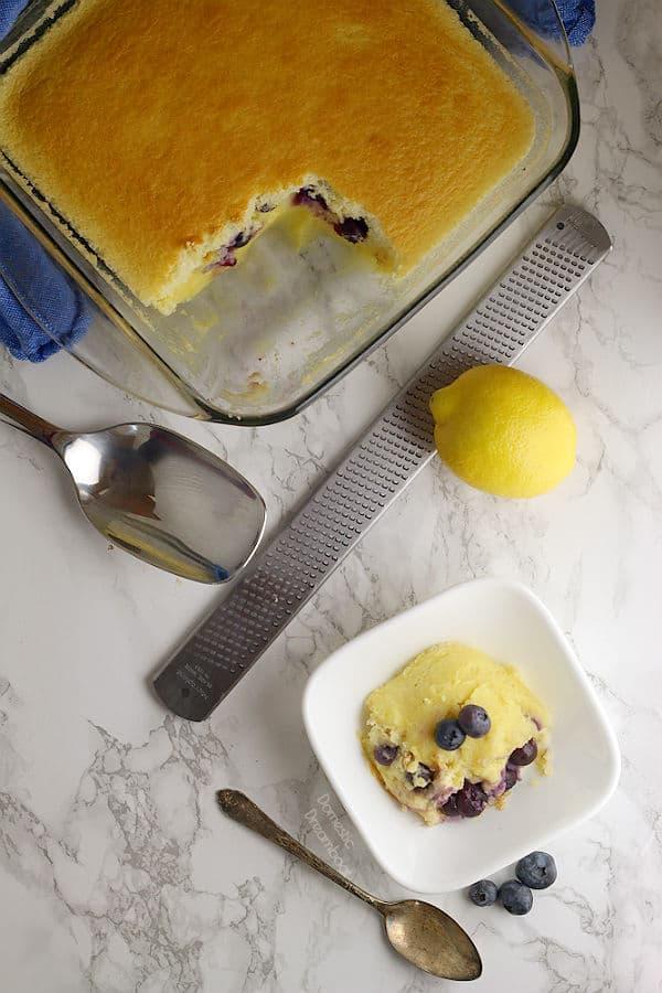 Lemon Blueberry Pudding Cake - Domestic Dreamboat #dessert #lemon #blueberry #puddingcake